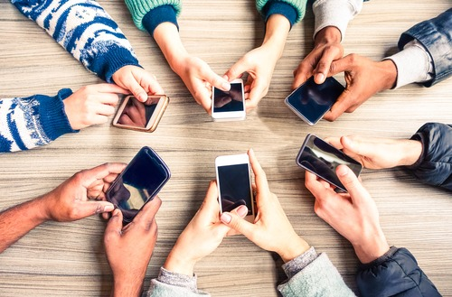 hands in with cell phones