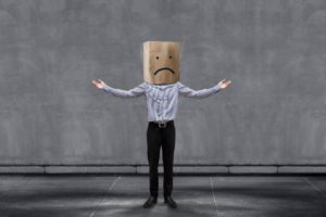 Unhappy Businessman with bag on head