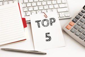5 tips written on paper on top of keyboard
