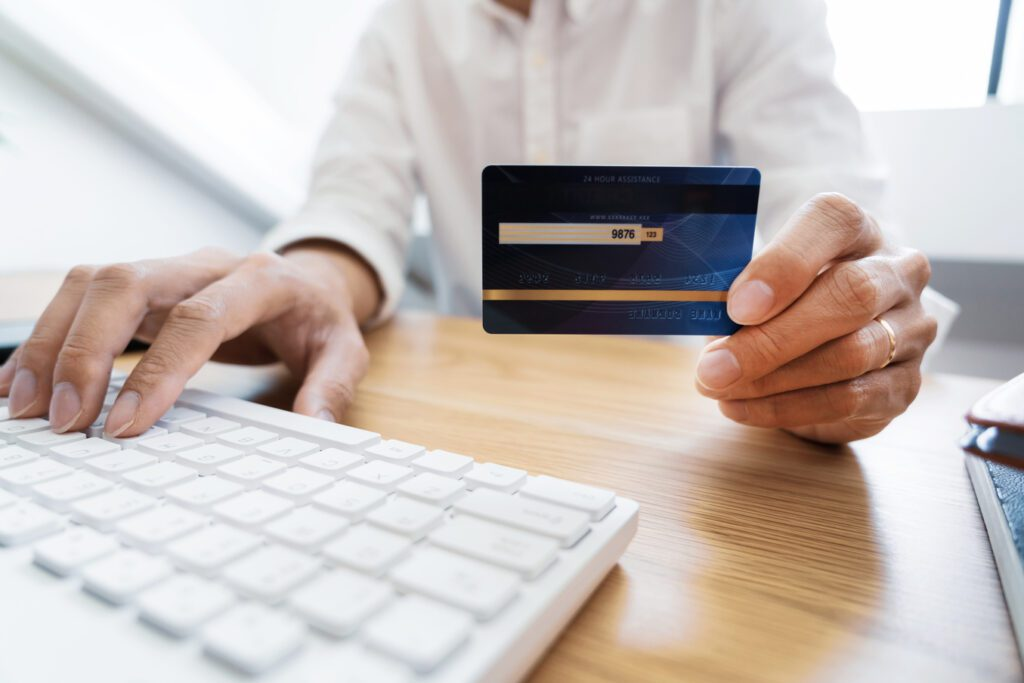 man holding credit card personal information online
